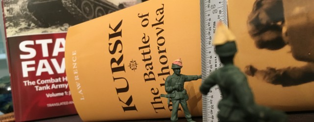 green army men measure a very large book