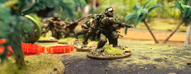 Japanese figures in jungle terrain